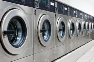 A row of five washing machines
